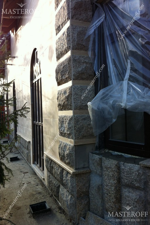 Облицовка фасада натуральным камнем - фото